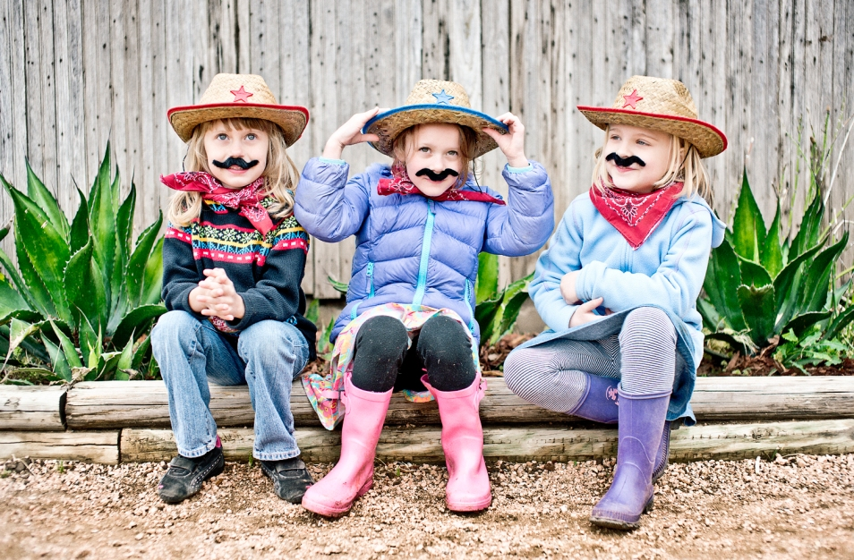 girls wearing moustaches